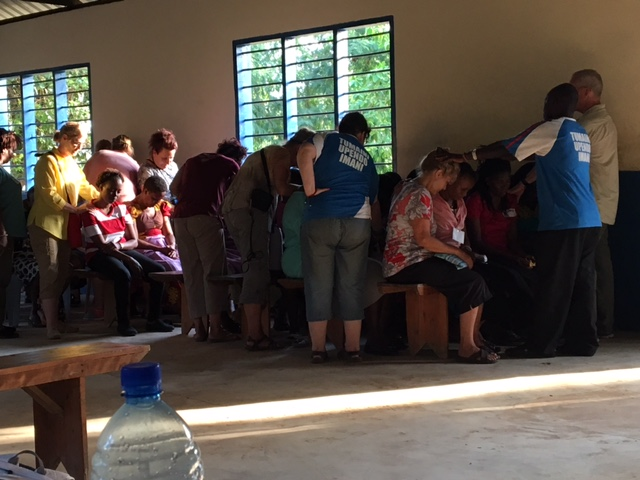 Prayer over our Bomani partners before our final departure.