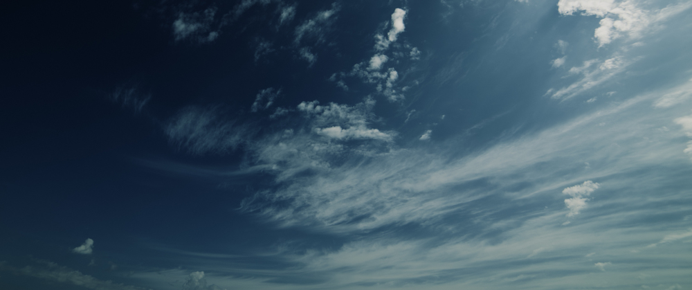 Cirostratus and patches of altostratus are present in this frame.