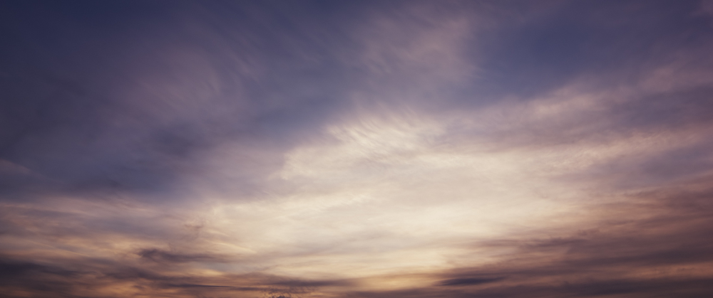 A layer of cirrus clouds during the sunset.