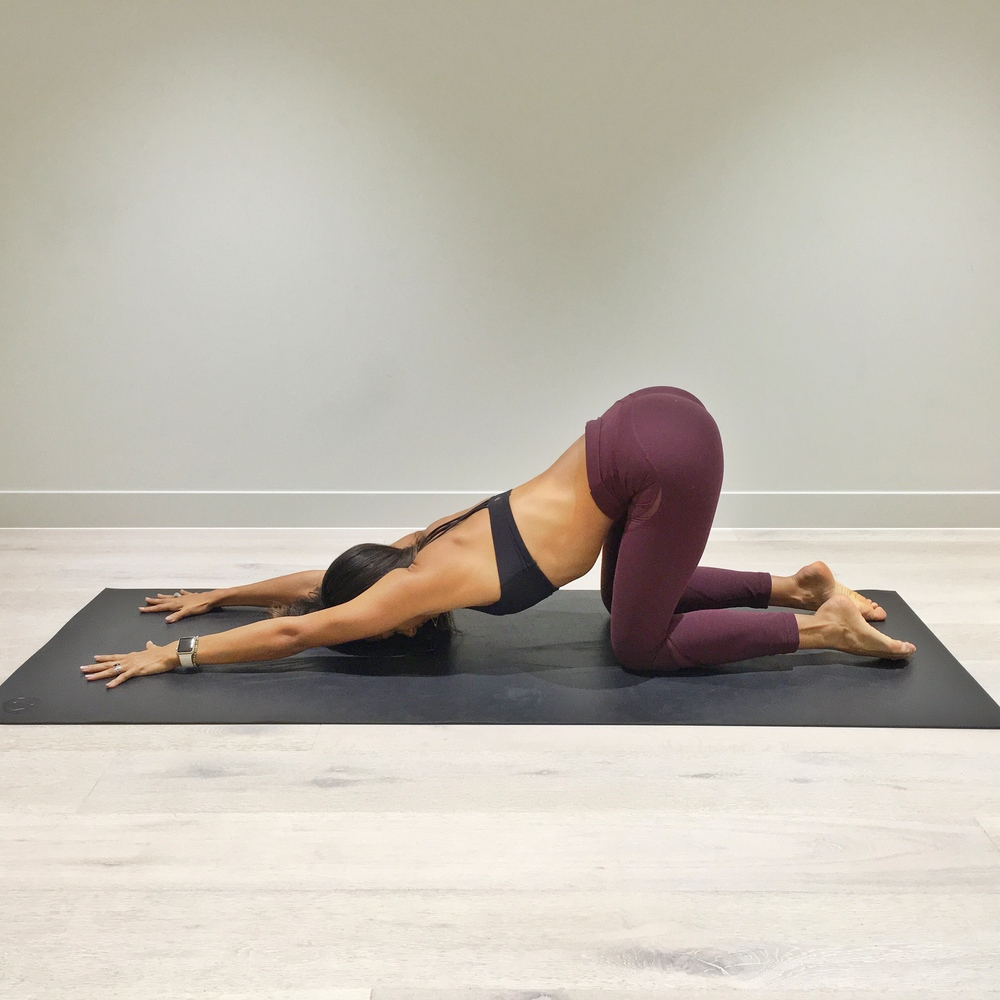 4. Start in an all fours position. Walk the hands forward, being careful to keep your hips above the knees as you do. Try to keep your arms straight as you let your lower ribs become heavy and drop to the floor.