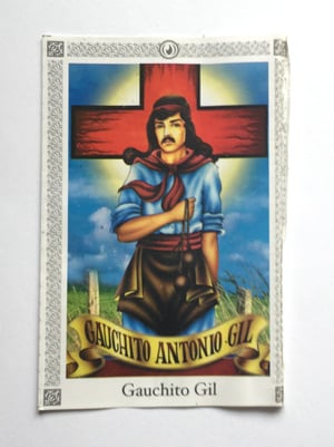 Cards with Gauchito Gil's image & prayer are used with money as offerings at the Tsogyelgar shrine.