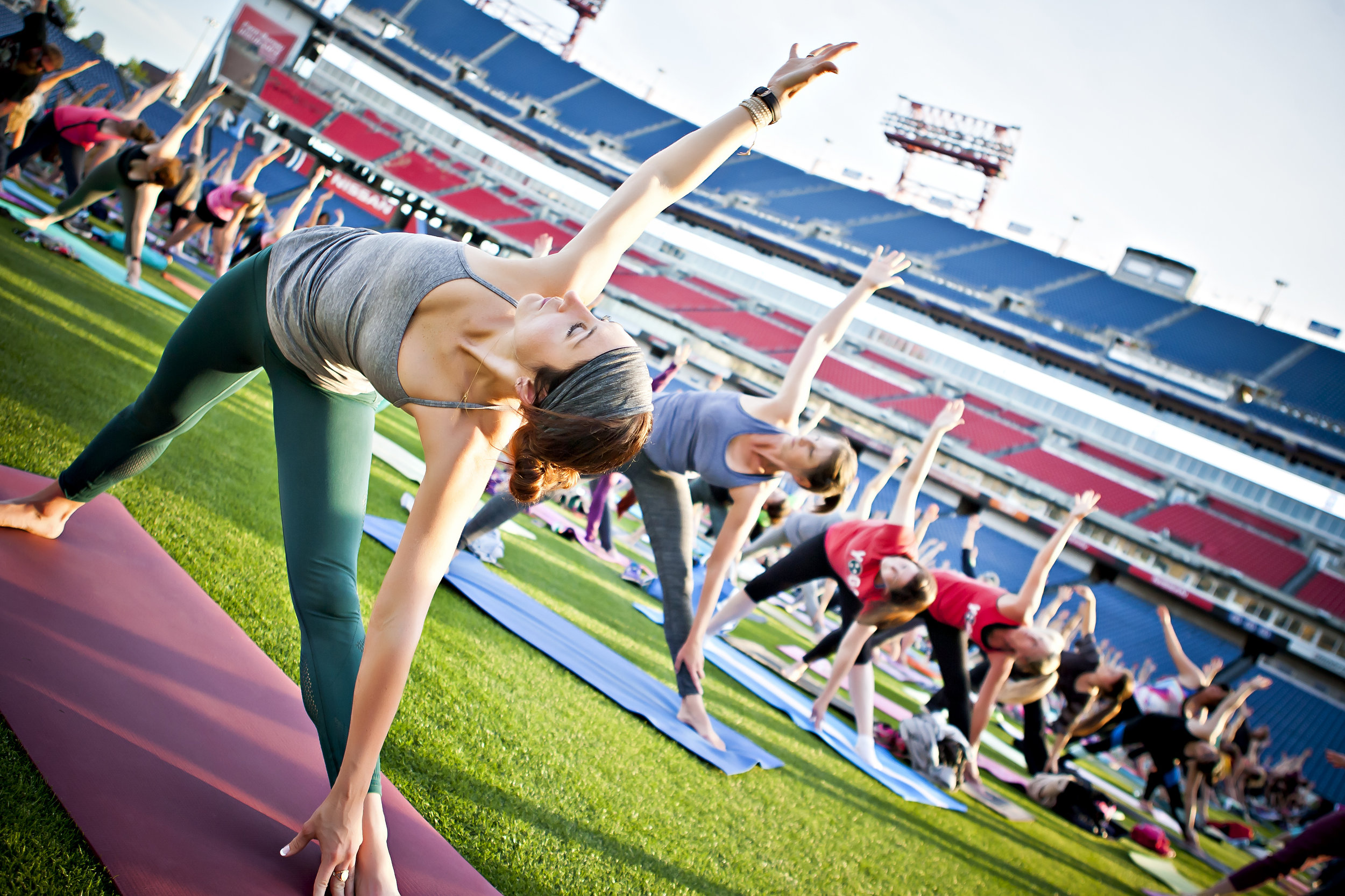 Image result for yoga on football field