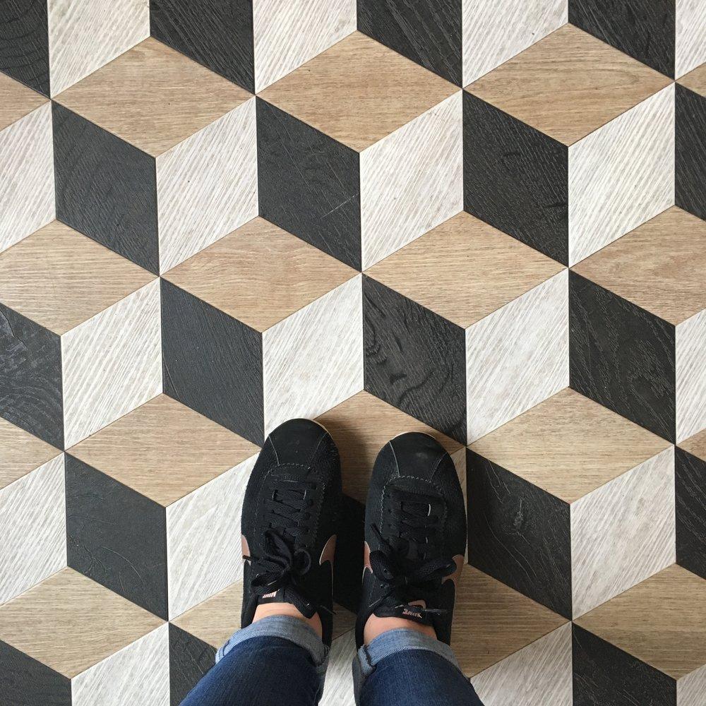 Floor tiles in the entrance hallway.