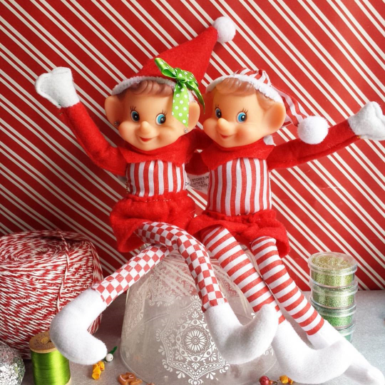 girl and boy elf on the shelf