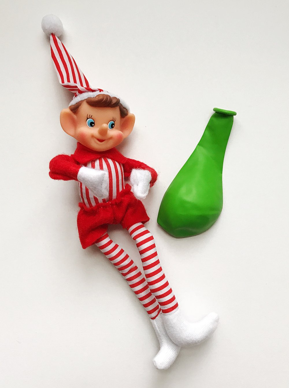 "Step 1 - Gather your supplies:- Your favorite elf- A regular balloon (10-12"")"