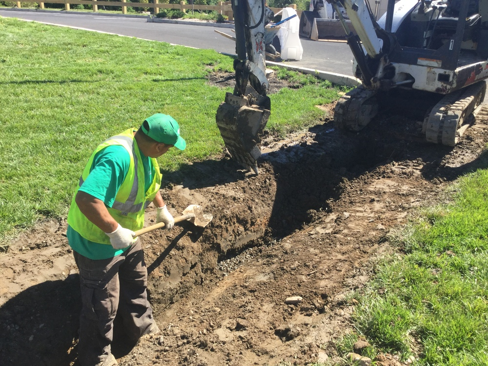 Grasskeepers Landscaping laborers and operators work together to complete the drainage and sub drainage work required for the project's completion.