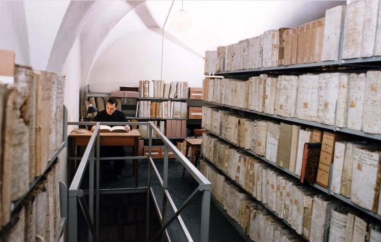 A prelate studies Inquisition documents in the Vatican Archive. (Photo by Arturo Mari, L'Osservatore Romano, HO via AP)