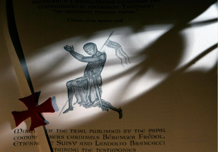 A detail is shown on a replica document in which Pope Clement V absolved the Knights Templar of charges of heresy. A reproduction of the Latin-language minutes of trials against the Knights Templar in 1308, lost until its rediscovery in 2001. (Photo by Alessandro Bianchi/Reuters)