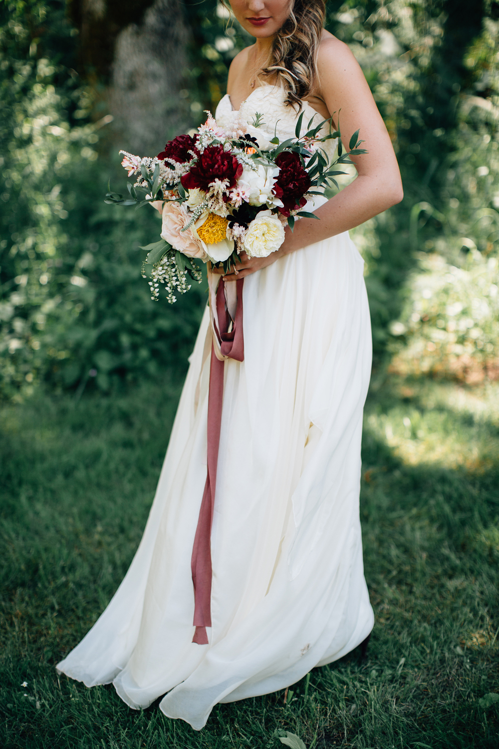 bridal wedding dress and bouquet with ribbon