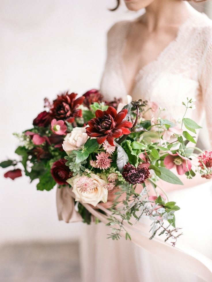 popping red dhalias and white garden roses