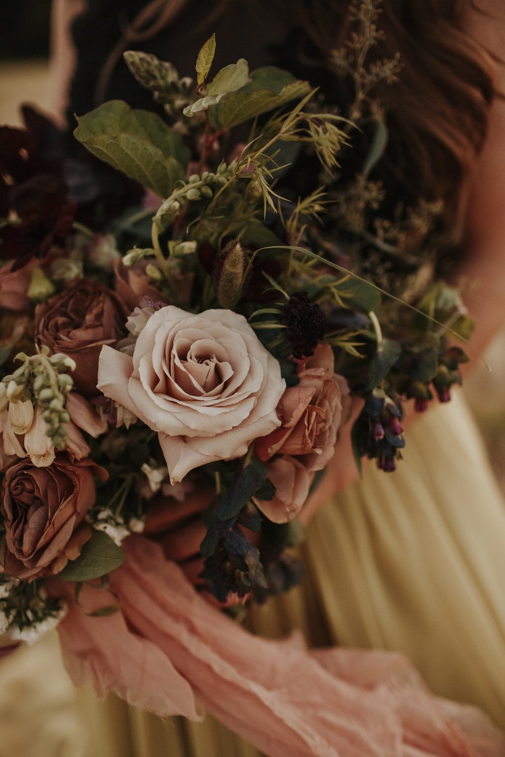 blush with whimsical greenery in bouquet