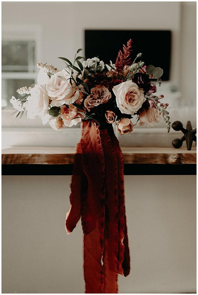 ribbon around wedding flowers
