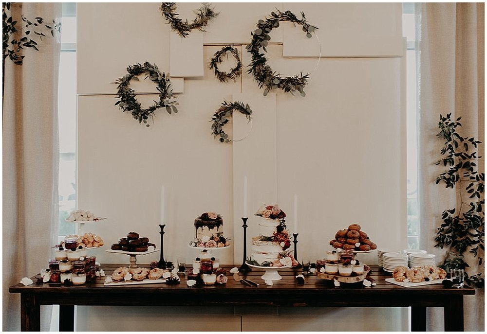 floral wreaths above cake florals