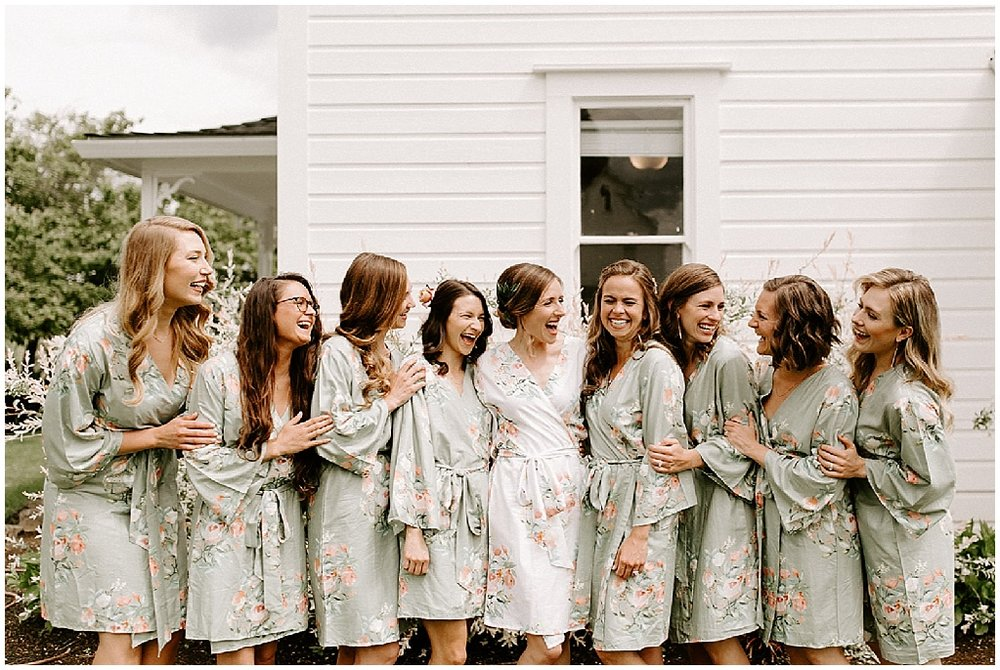 bridal party in floral print gowns