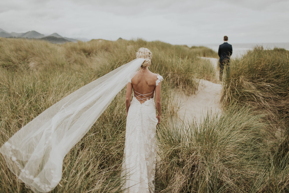 oregon coast wedding first look bride and groom