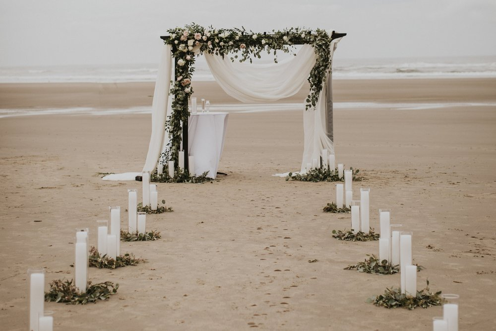 wedding arbor with floral garland on the oregon coast
