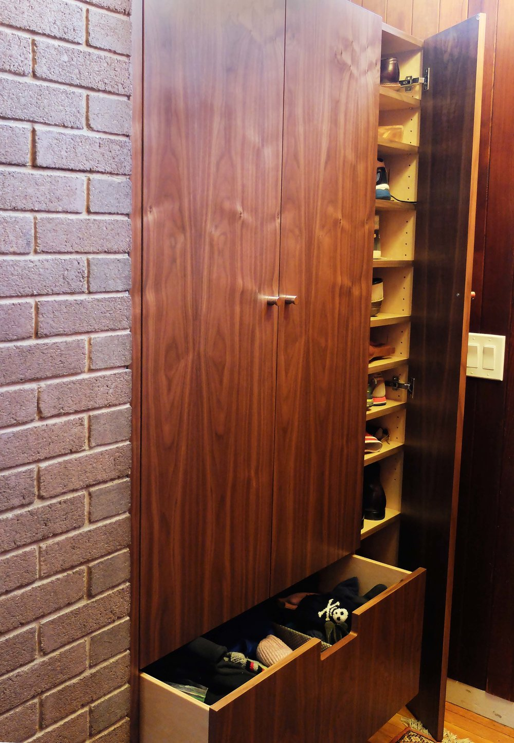 Honore-Cabinetry-custom-modern-walnut-hall-closet.jpg