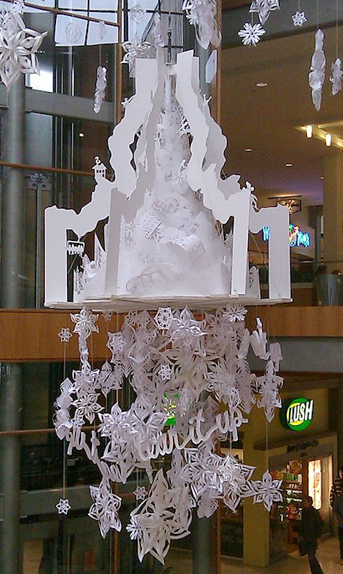 Tear it up. - Installed November 2010 - Bellevue, WACommissioned by Drake Cooper & Idaho Board of Tourism20' cut paper sculpture suspended in the center atrium of Bellevue Square Mall in Bellevue, WA. Design, built, cut & installed along with Kira Green & Shannon Nesbitt.We installed it in time for the Holiday shopping season to promote the Idaho tourism. Below was a floor installation of posters with information about Idaho ski resorts & an interactive giveaway. We also created a large-scale postcard backdrop for shoppers to be able o take photos in front of.Was taken down and stored for 2 years & we reinstalled it at Pacific Place Mall in Seattle, WA in December 2012.