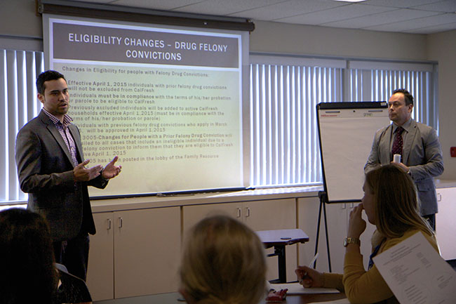 Albert Garcia and Ismael Lopez from the County Health and Human Service Agency present on changes to eligibility guidelines as result of lifted drug felony ban at February 26  th   CalFresh Task Force meeting.  (Photo by Kimberly Powers)
