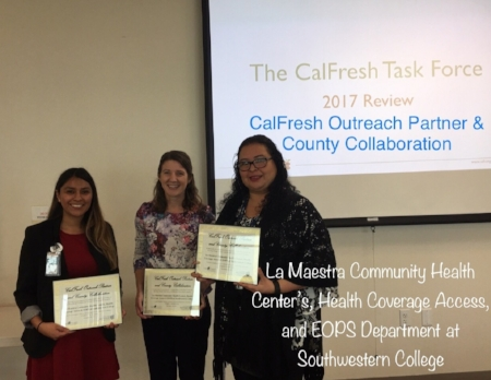 San Diego Hunger Coalition Senior Director of CalFresh and Advocacy, Amanda Schultz Brochu presents Daniela Cervantes of La Maestra Community Health Centers and Monica Moreno of Health Coverage Access with the CalFresh Outreach Partner and County Collaboration award.