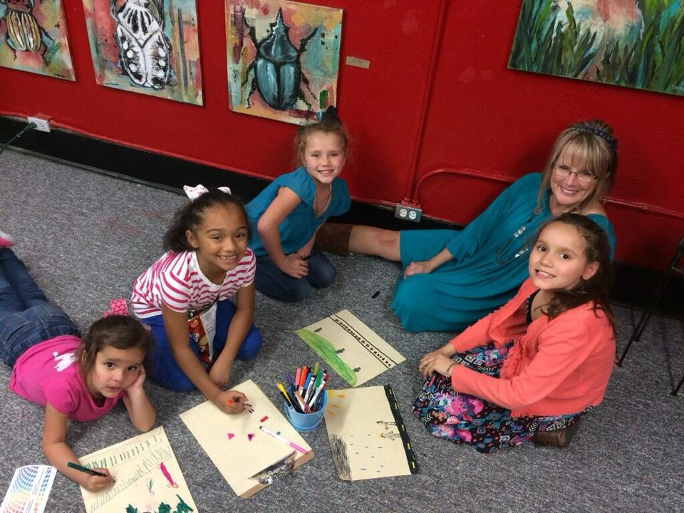 This adorable group of young artists camped out in the corner and drew lots of great pictures for us!