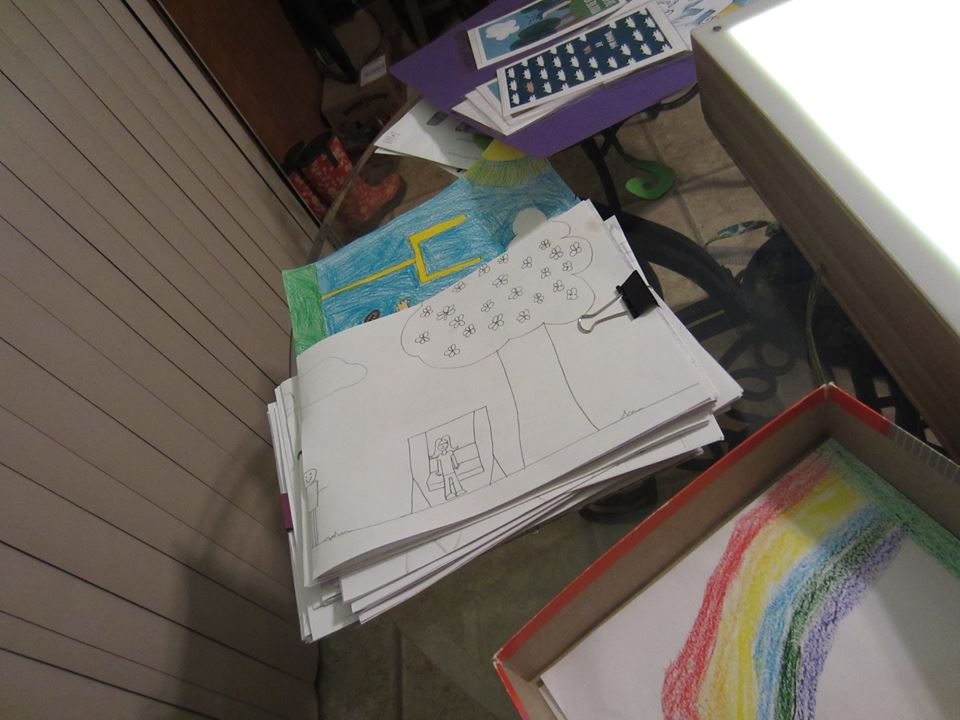 Unfortunately, we did not think to take a photo of the huge piles of drawings we started with, but this at least shows part of the beginning stage of sorting.