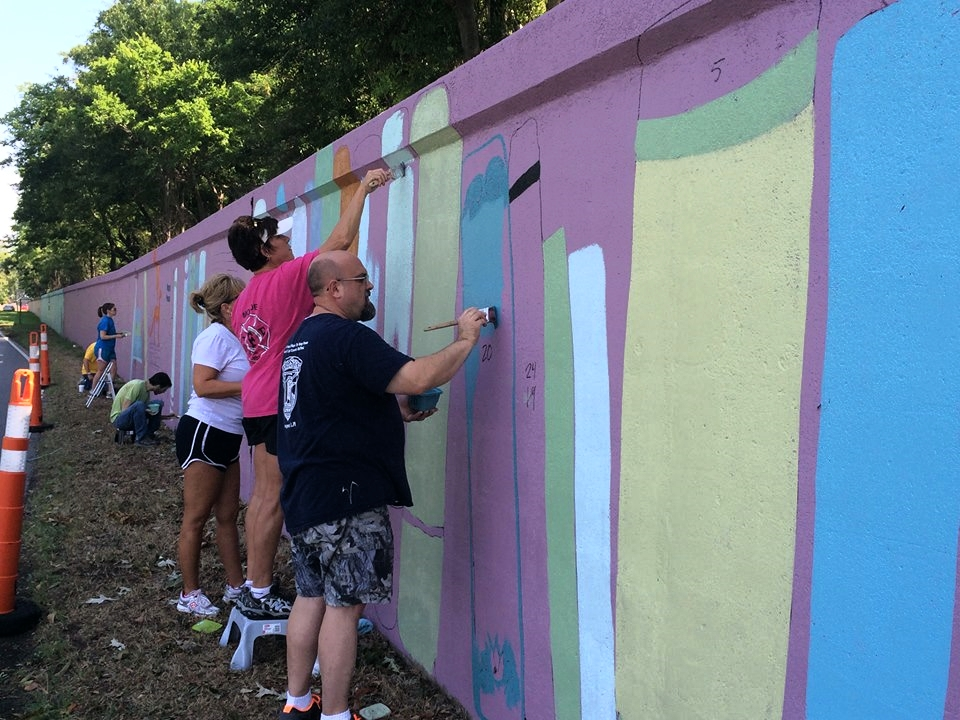 Members of the West Monroe-West Ouachita Chamber of Commerce lending a hand during the painting process.