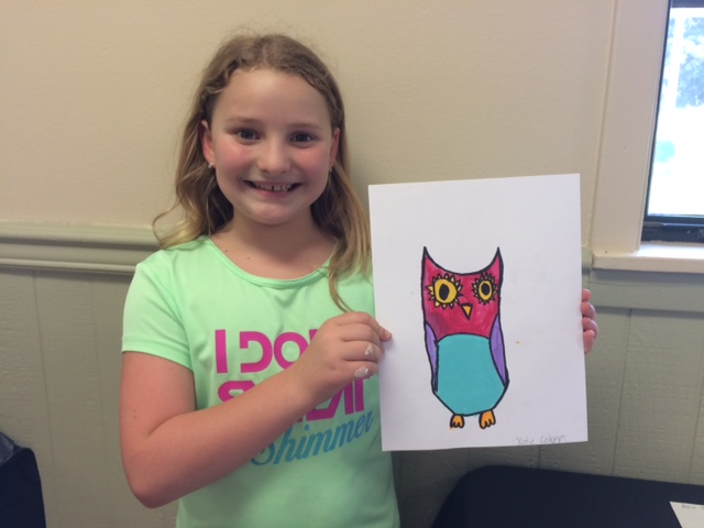 Katie Coker shows off her cute and colorful owl. Katie is a student at Claiborne Elementary and attends MoJoy Studio for art classes where she created this drawing.