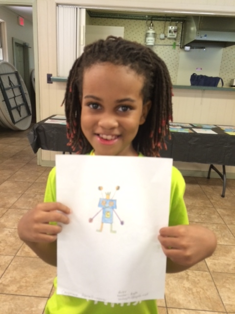 Excuse the slightly blurry photo, but this little dude is just too adorable! Christiaun Harrell's  tiny robot drawing is so much fun. He is a student at Boley Elementary.