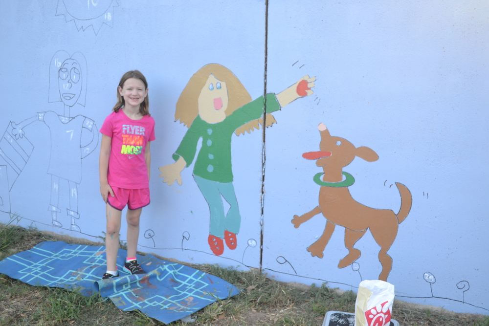 She painted the girl pretty much all by herself. Mrs. Donna painted the puppy. They were a great team!