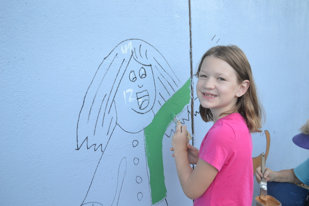 Audrey is a seven year old artist who got to come out to paint the image she had drawn. We love her picture of a little girl playing with her dog. Such a sweet girl!