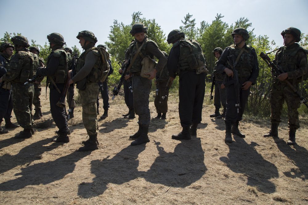 Ukrainian soldiers line up before a training exercise near Lviv, Ukraine, led by members of the U.S. Army's 173rd Airborne.