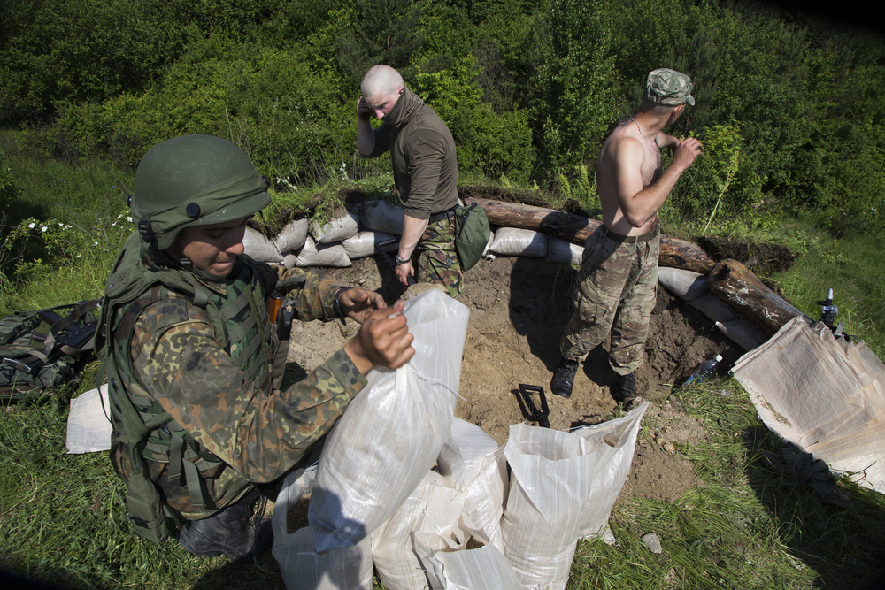 "Ukrainian soldiers dig a fighting position during a 48-hour ""war games"" exercise versus members of the U.S.'s 173rd Airborne at a military base outside of Lviv, Ukraine."