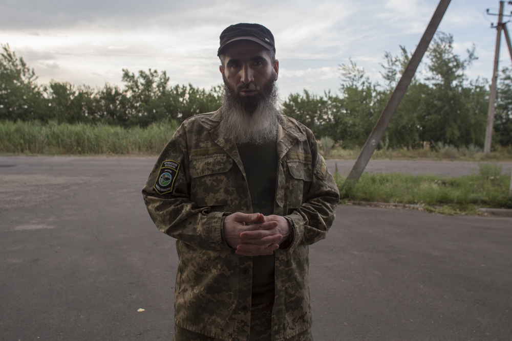 Muslim, a Chechen commander who has fought Russian aggression in several countries, speaks about his experiences in the Chechen war in his base that he shares with Right Sector, a Ukrainian far-right nationalist group.