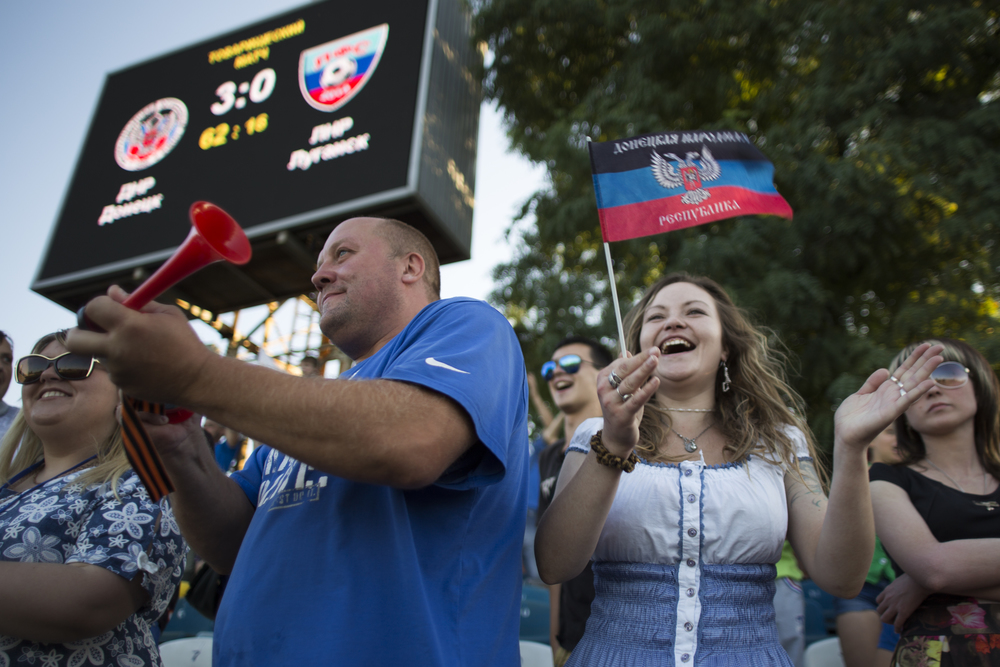 Fans of the Donetsk People's Republic cheer on their team during the first official match between Donetsk and Luhansk, semi-autonomous republics currently engaged in a Russian-backed proxy war with Ukraine. ©Jack Crosbie, 2015.