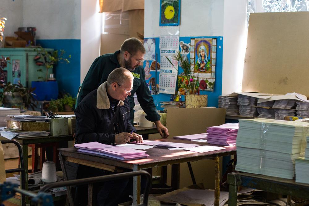 Newspaper employees check and sort stacks of freshly printed ballots in Mariupol, Ukraine. ©Jack Crosbie, 2015.
