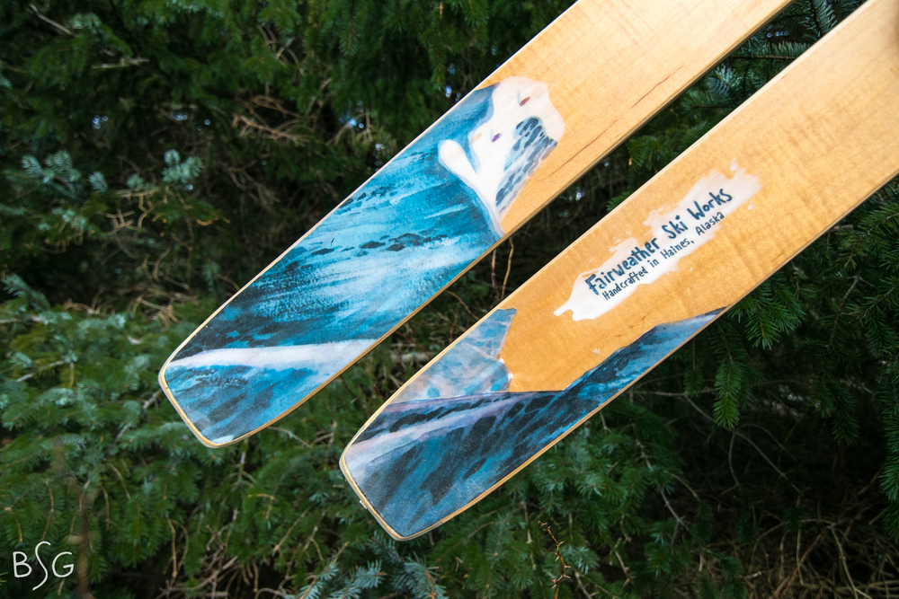 Fairweather skis are uniquely Alaskan- constructed with sustainably sourced local woods and detailed with the work of local artists. This pair showcases a painting by John Svenson.