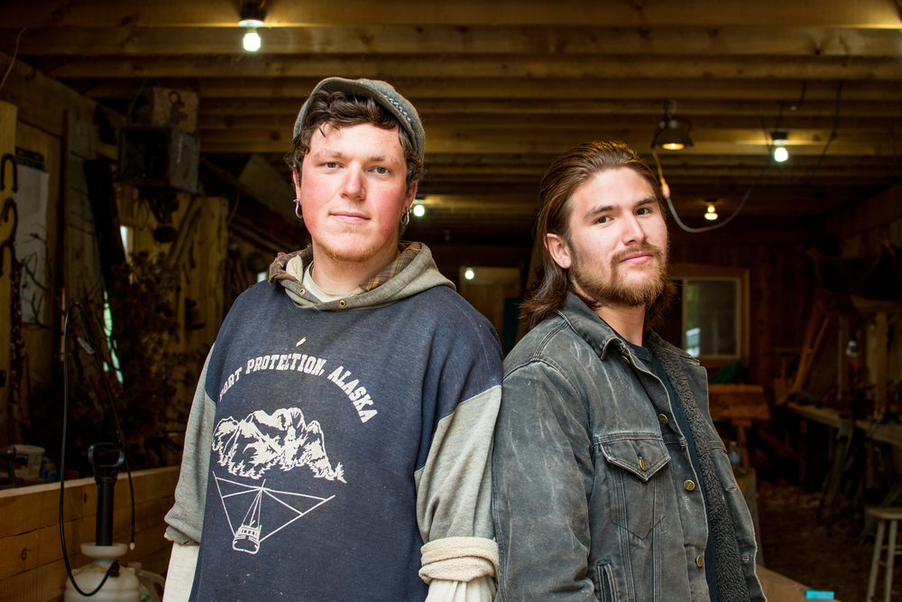 Eric Hamar (left) and Harley Bell-Holter (right) stand in the doorway of the Kasaan Community Carving Shed.