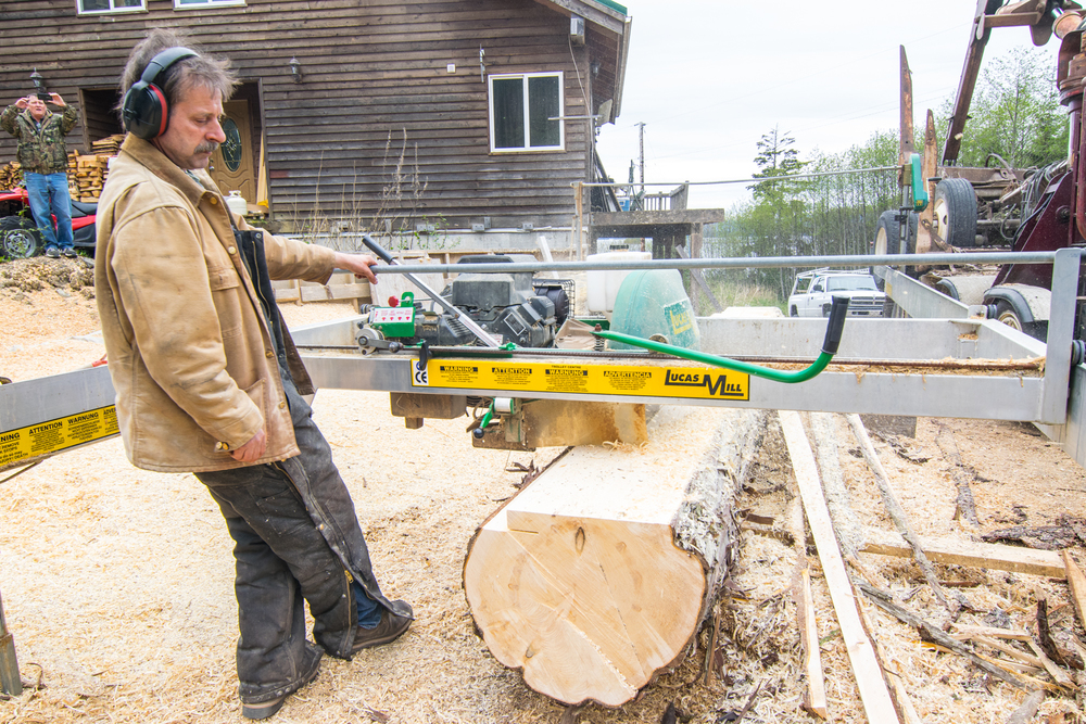 Kevin Merry milling locally harvested timber at his saw mill in Kake, Alaska