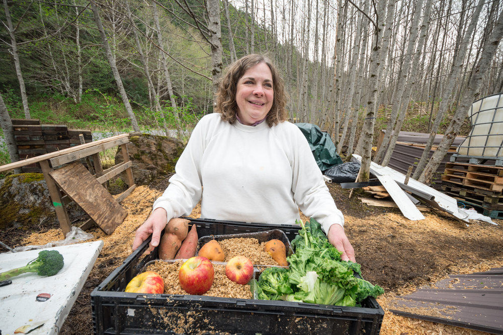 Bobbi Daniels is responding to the many challenges that her rural Alaskan community faces with creativity and innovation. Here, she prepares to feed food waste from the local grocery store and spent brewery grains from the local brewery to pigs and poultry.