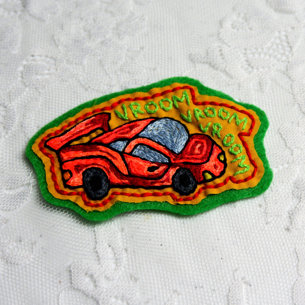 Eliza McKinney - Hand-embroidered car patches, t-shirts, and tote bags