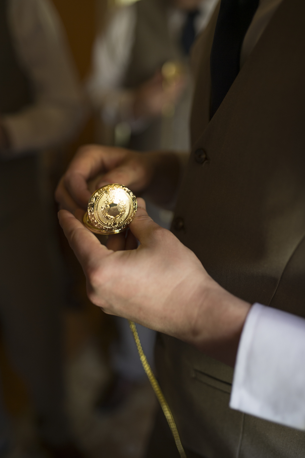 Photocredit: Amberlee Christey              This gorgeous gold pocket watch is the perfect accent for the groom who                                                                                 knows the importance of making it to the ceremony on time.