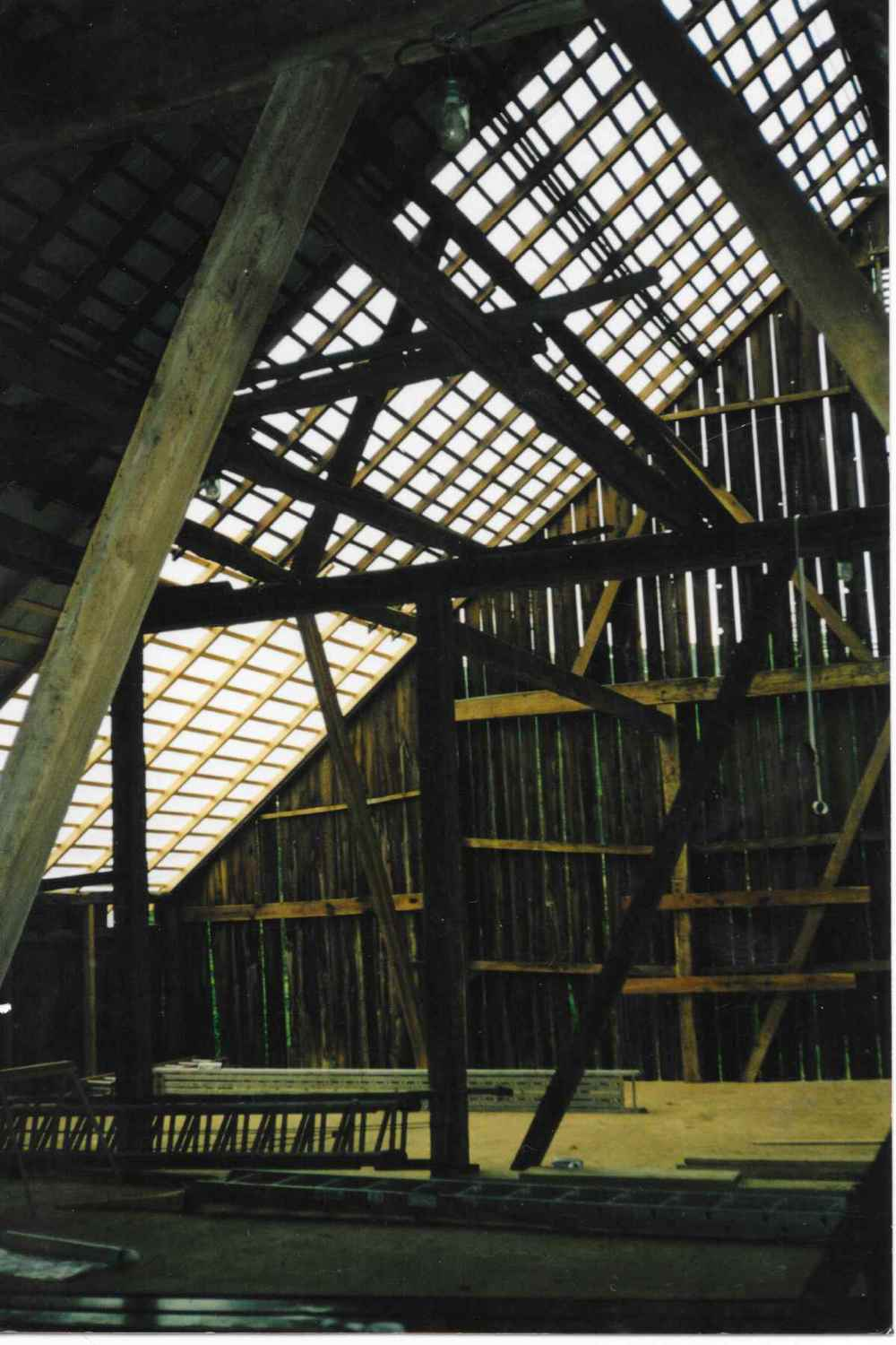 The upper story of the barn at Chanteclaire Farm during renovation.  Note the work occurring on the roof.