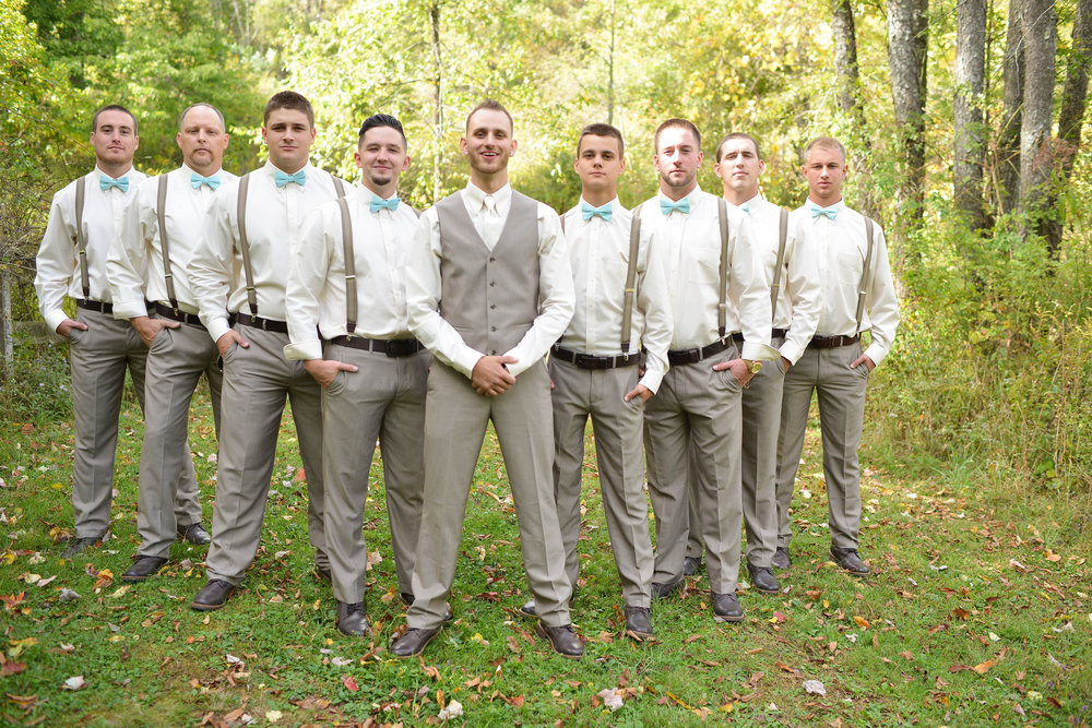 Photocredit: Grace Photography                                   Bowties and suspenders hit the mark for this groom's party.