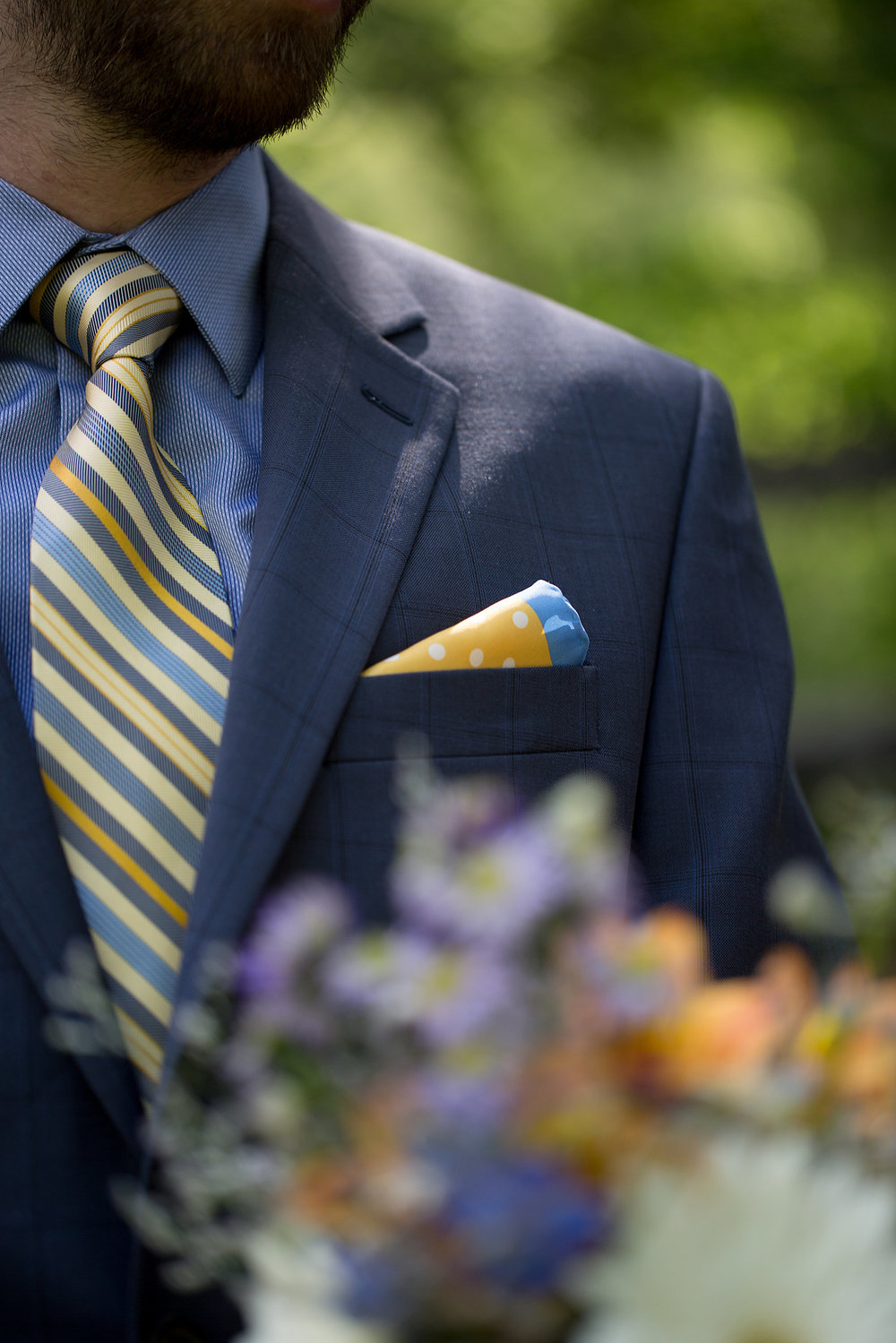 Photocredit: The Happy Couple              The fun colors and coordinating patterns of the tie and pocket square                                                                                                        make this groom's look really pop.