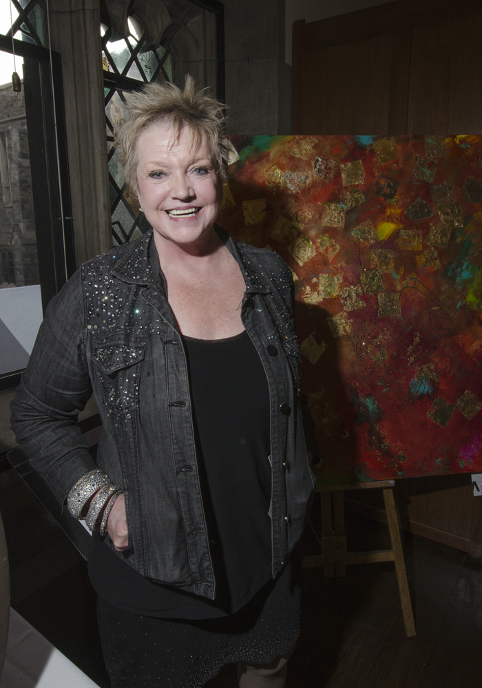 Barbara McGivern with one of her paintings
