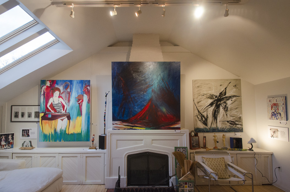 The painting 'Maiden Flight' to the right of the mantle