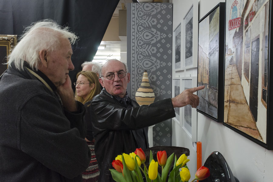 David Lovett with his paintings and fellow artist Leon Rooke