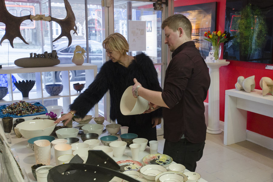Fran Hill looking over some ceramic bowls by Filipa Pimentel