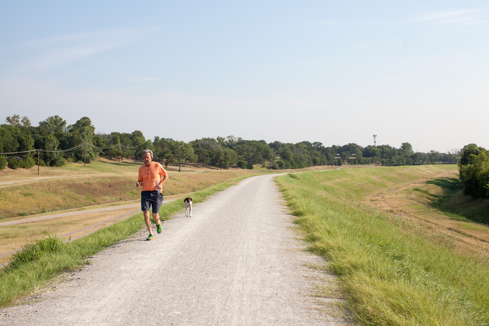 Runner with dog, Trinity River path, July 2013. Terry Evans